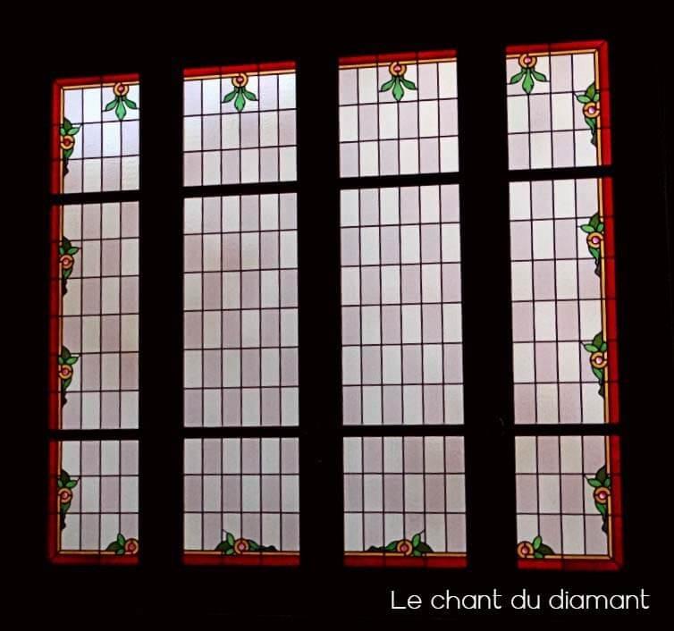 Baie vitrée à vitrail restauré en totalité